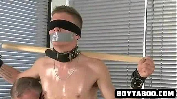 Restrained and blindfolded hunk getting tugged