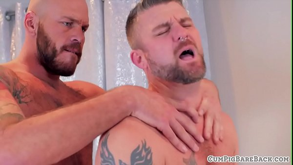 Tattooed bear seduced by his muscular lover
